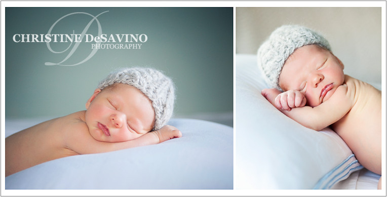 Adorable newborn boy in knit hat resting on a pillow.