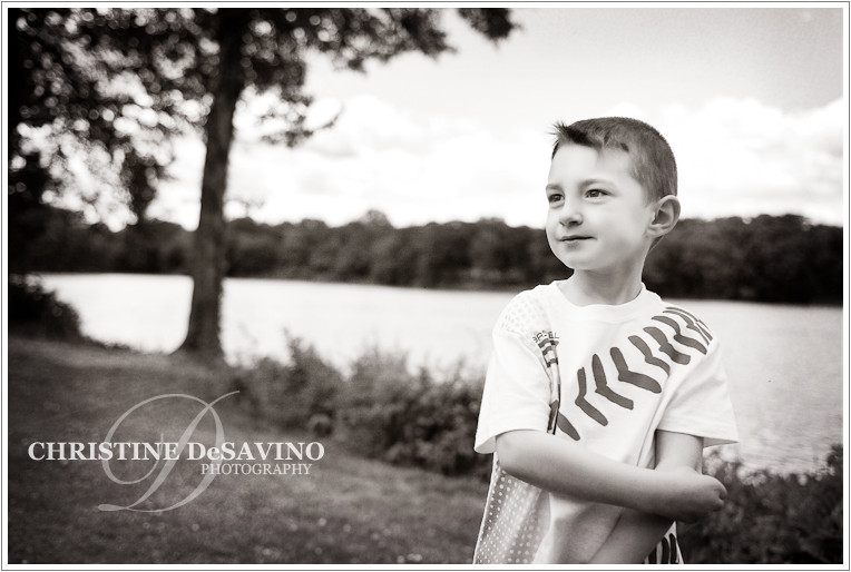 black-and-white-photo-of-boy-near-Congers-Lake