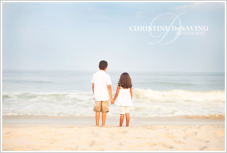 Brother and sister hold hands by ocean - NJ Beach Photographer - LBI, New Jersey
