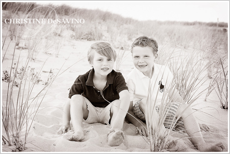 Black and white image of two brothers on the dunes - NJ Beach Photographer