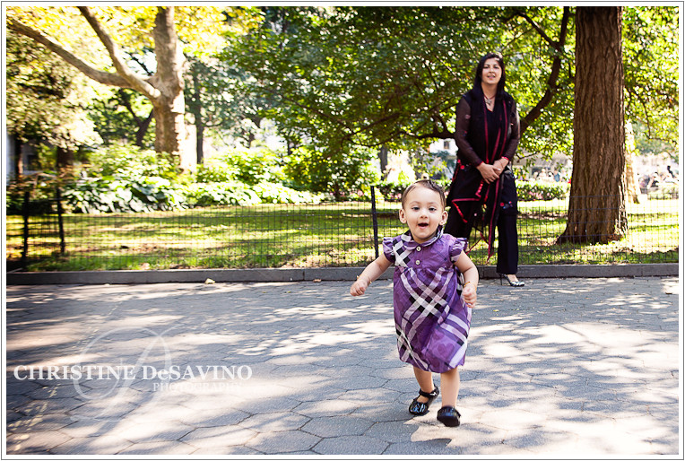 Girl running in Madison Square Park - NYC Child Photographer