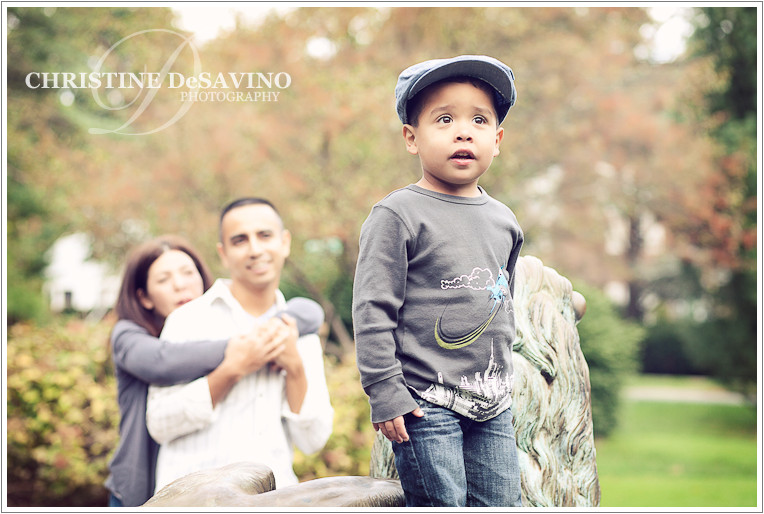 Adorable boy with parents looking on - NJ Children's Photographer