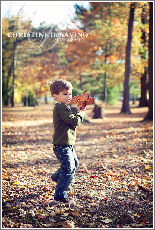 Boy flying wooden plane - NJ Children's Photographer