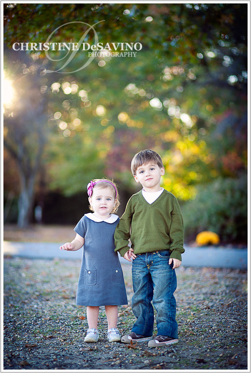 Beautiful girl and boy with sunflare - NJ Children's Photographer
