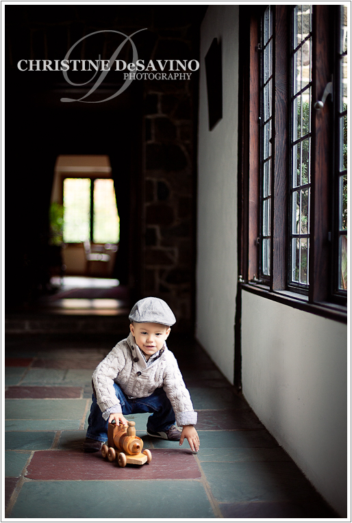 Boy plays with train by window - NJ Child Photographer