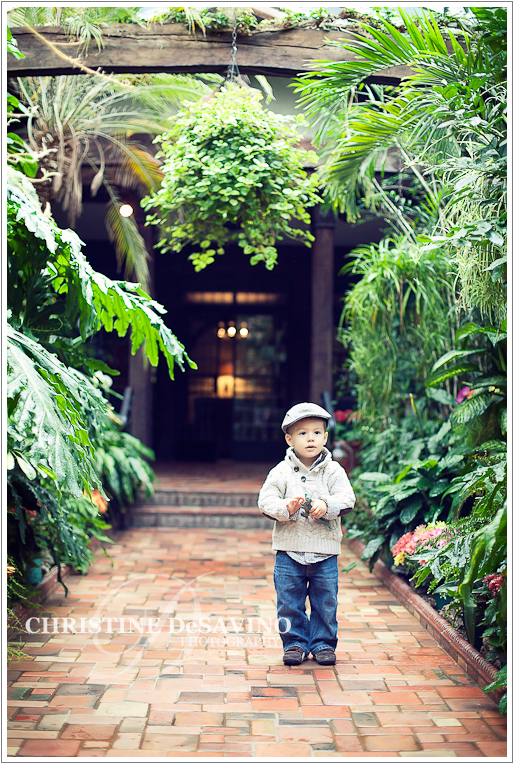 Boy standing in greenhouse - NJ Child Photographer