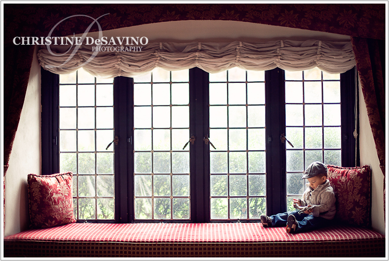 Boy sitting in window sill - NJ Child Photographer
