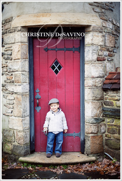 Boy by a red door - NJ Child Photographer