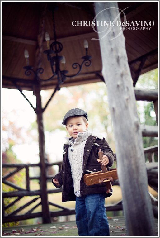 Boy on gazebo with wooden airplane - NJ Child Photographer