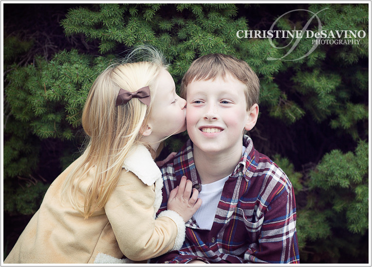 Sister kissing brother - NJ Child Photographer