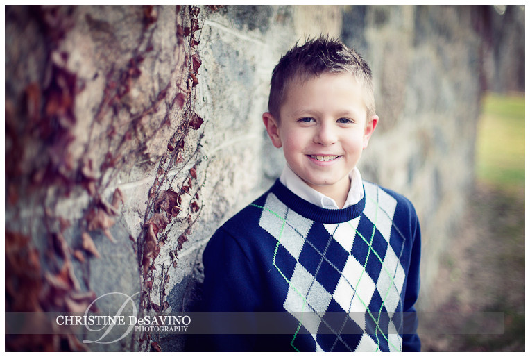 Handsome boy leans against stone wall - NJ Child Photographer