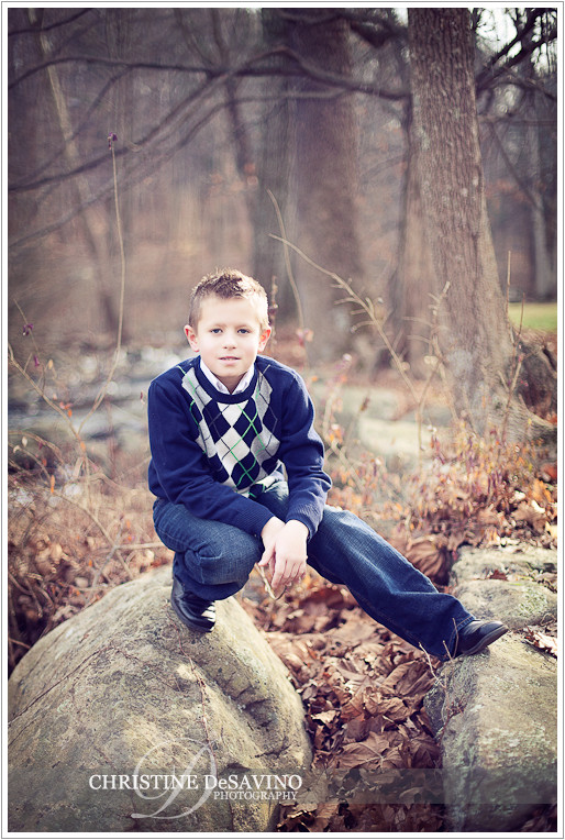 Boy kneels by rocks - NJ Children's Photographer