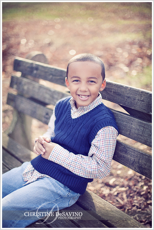 Boy smiling on a bench - NJ Children's Photographer