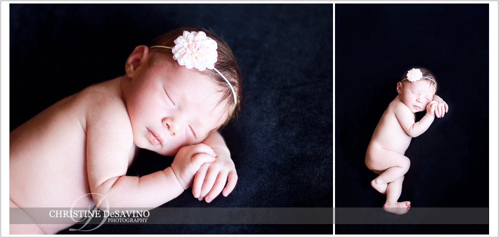 Newborn girl on black with flower headband - NJ Newborn Photographer