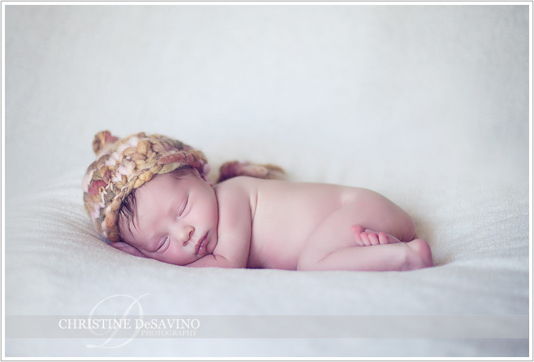 Newborn girl on white with knit hat - NJ Baby Photographer
