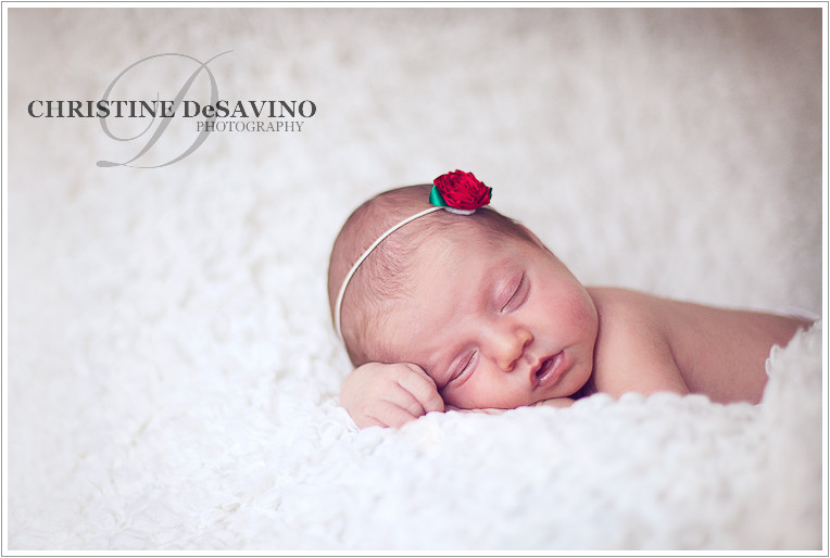 Beautiful newborn girl sleeping with red flower headband - NJ Newborn Photographer