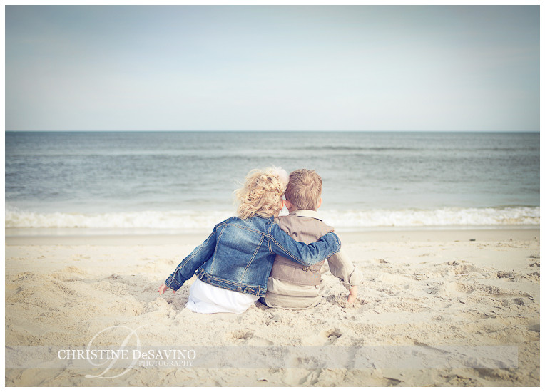 Sister and brother look out at ocean - NJ Beach Photographer