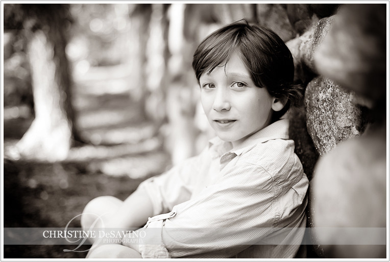 Boy sits against stone wall - NJ Child Photographer