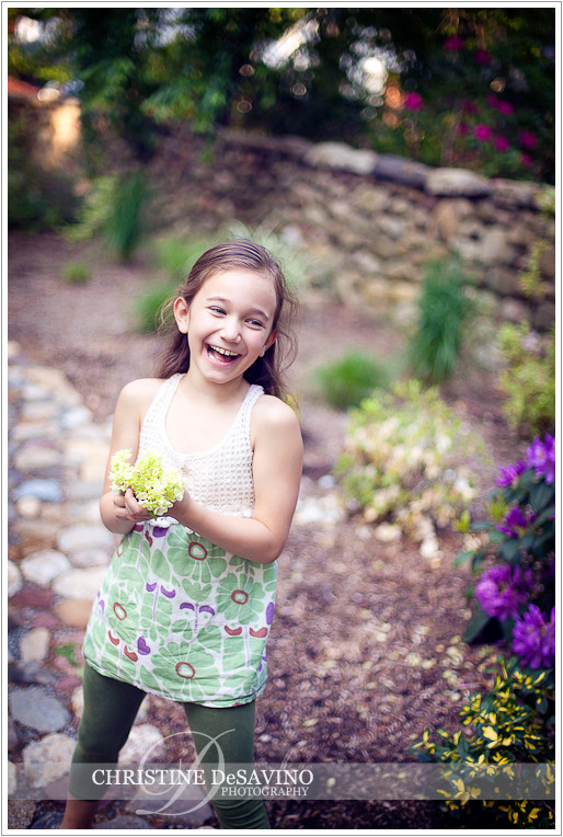 Girl with flower laughing - NJ Children's Photographer