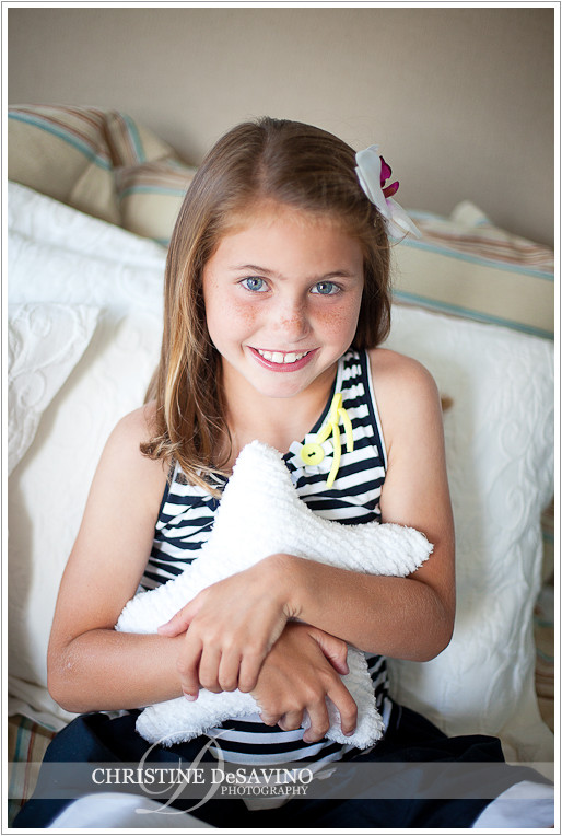 Beautiful girl hugging pillow - NJ Child Photographer