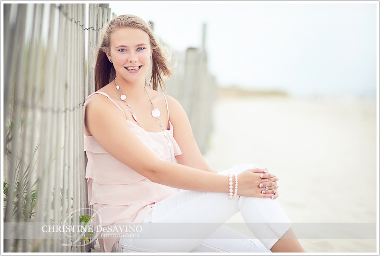 Beautiful girl sitting in sand dunes - NJ Beach Photographer