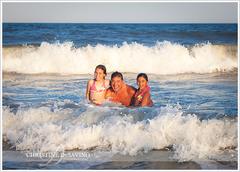 Family swimming in ocean at LBI - NJ Beach Photographer