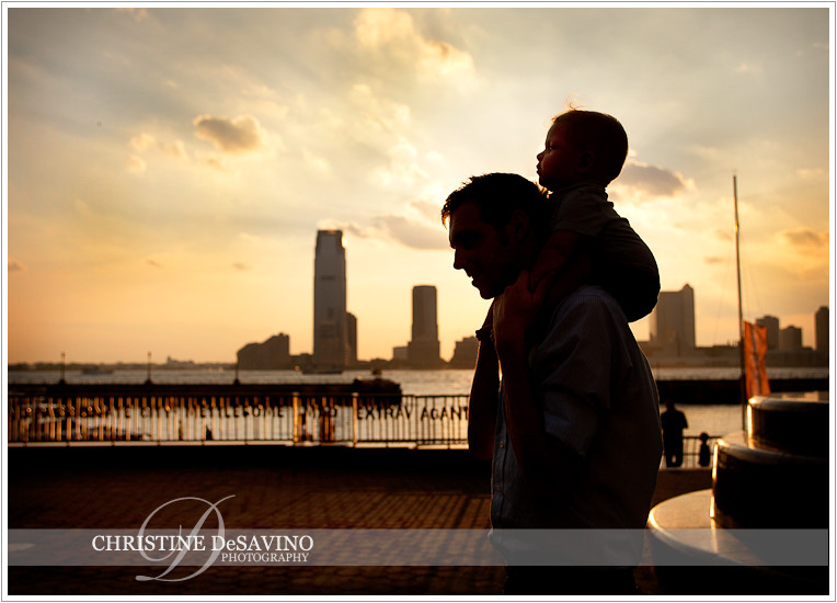 Silhouette of father and son along Hudson River - NYC Family Photographer