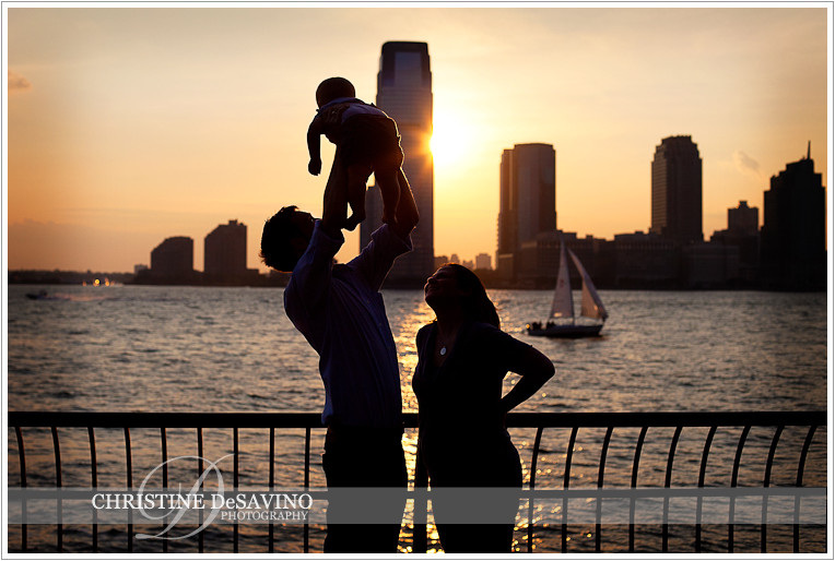Silhouette of family along Hudson River - NYC Family Photographer