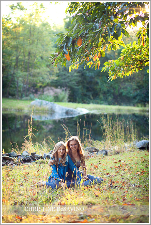 Sisters sunlit by pond - NY Portrait Photographer