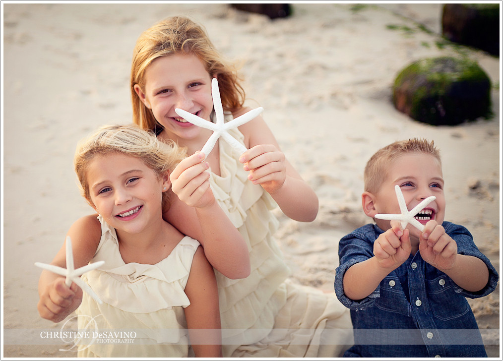 Siblings with starfish - NJ Beach Photographer