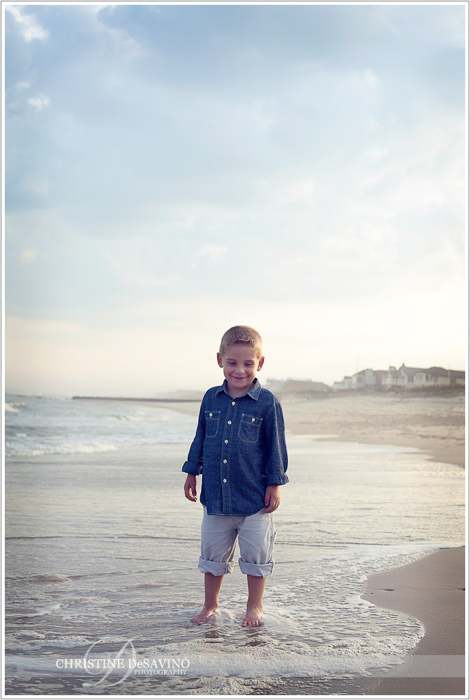 Boy wades in ocean  - NJ Beach Photographer